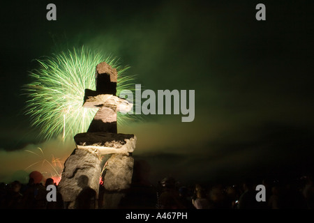 View of Symphony of Fire/Celebration of Light fireworks celebration and Inukshuk in Vancouver, British Columbia, - Stock Photo