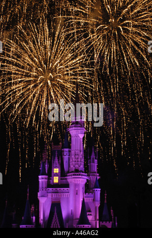 Disney World Magic Kingdom Cinderella Castle at night fireworks action display dazzle magical dark background - Stock Photo