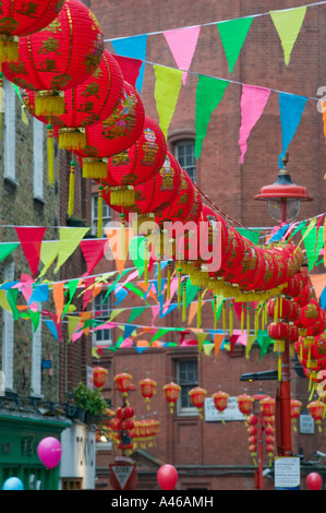 Row of red Chinese lanterns hanging above Newport Place, New Year parade, Chinatown, London, England, UK - Stock Photo