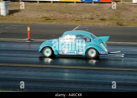 Vw beetle drag car cal look Californian wheelie bar at speed fast - Stock Photo