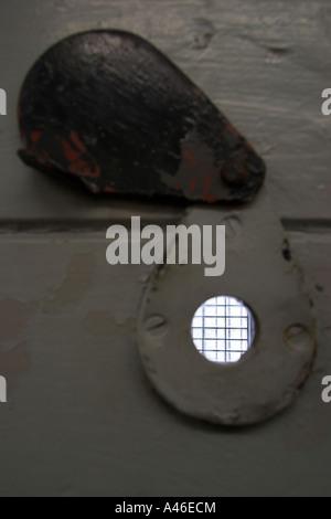 Spy hole in the door in the Hohenschoenhausen prison, Berlin, Germany - Stock Photo