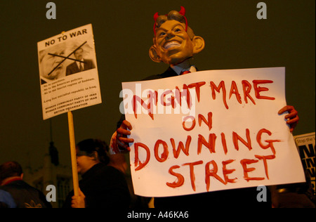 halloween protest in london against war in iraq a protester wears a tony blair mask and devil horns at a halloween - Stock Photo