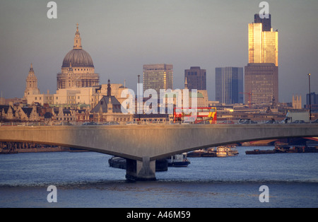 A view of Waterloo Bridge crossing the River Thames in London, showing St Pauls Cathedral and the Nat West Tower - Stock Photo