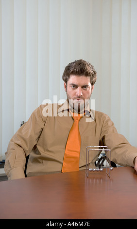 Angry looking businessman - Stock Photo