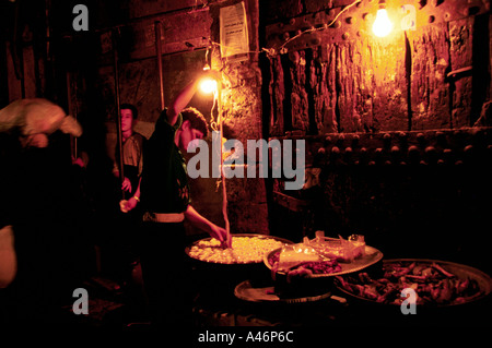a boy claening animal intestines in the souk aleppo syria - Stock Photo
