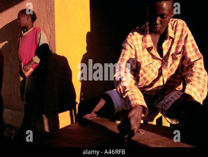 orphans at shalom house play checkers in the evening sun both hutu and tutsi children live here ruyigi burundi - Stock Photo