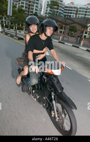 Young asian couple on moped - Stock Photo