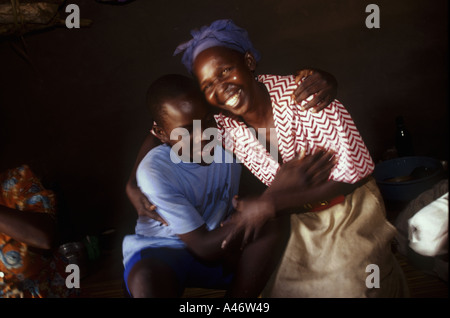 A boy abductee fighter from the Lords Resistance Army reunited with his mother and family, Gulu, Northern Uganda - Stock Photo