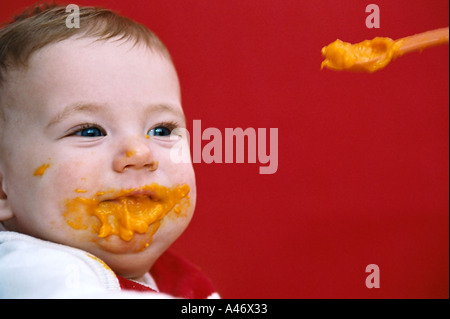 Baby being fed - Stock Photo