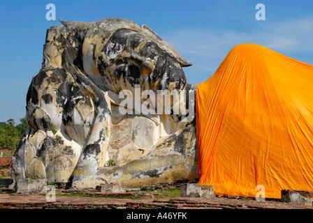 Head of a big reclining Buddha figure covered in orange cloth Lokayasutha Ayutthaya Thailand - Stock Photo