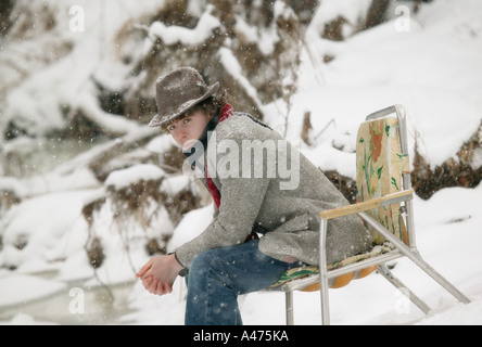 Sitting in the Snow - Stock Photo