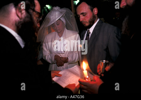 A Jewish couple are married by a Rabbi in an Orthodox wedding ceremony, Jerusalem, Israel - Stock Photo