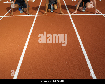 Male runners at starting line - Stock Photo