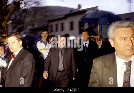 president milo djukanovic arriving at a public meeting with security men and bodyguards bielo polje montenegro - Stock Photo