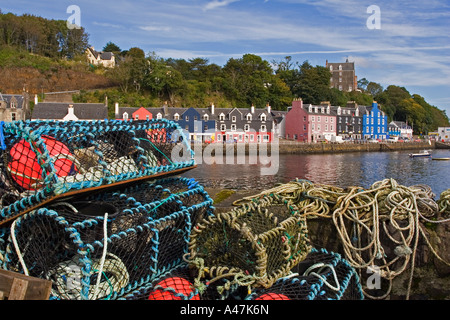 Lobster pots on harbour pier with view across to Tobermory town, Isle of Mull, Argyll and Bute, Scotland, UK - Stock Photo