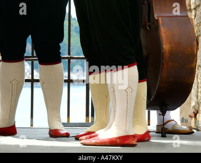 Legs of traditional dancers and musicians Dubrovnik Croatia - Stock Photo
