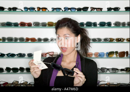 Woman shopping for sunglasses - Stock Photo