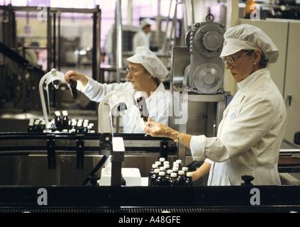 Checking bottles of eyewash . Boots pharmaceutical factory Nottingham - Stock Photo