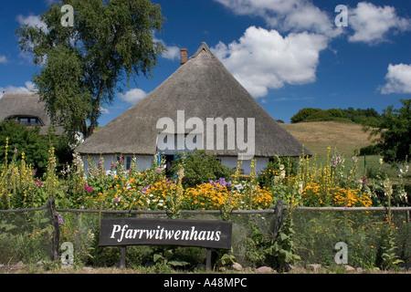 Reed roofed house / Wustrow / Pfarrwitwenhaus - Stock Photo