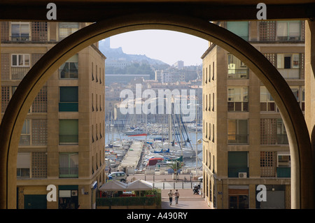 Panoramic view of seafront & Vieux Port through a archway Marseille Old Provence Southern France Europe - Stock Photo