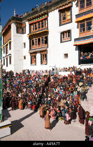 India Ladakh Leh Valley Spitok Gompa festival pilgrims watching dance in mnastery courtyard - Stock Photo