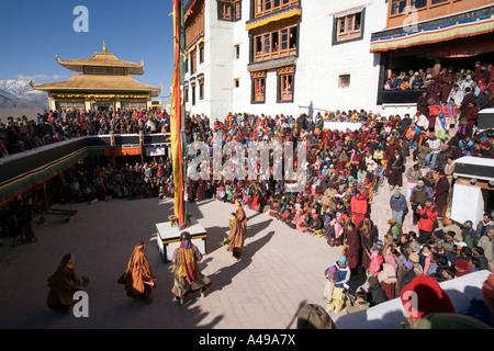 India Ladakh Leh Valley Spitok Gompa festival pilgrims watching dance in monastery courtyard - Stock Photo