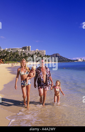 family at beach, USA, Hawaii, Honolulu - Stock Photo