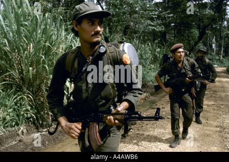 Kisan anti-Sandinista rebel Miskito Indian Contras preparing a raid across the Honduran border into Nicaragua, July - Stock Photo
