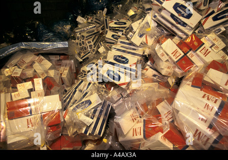 Cigarettes confiscated by UK Customs and Excise officers at Dover port from people trying to smuggle into the UK. - Stock Photo
