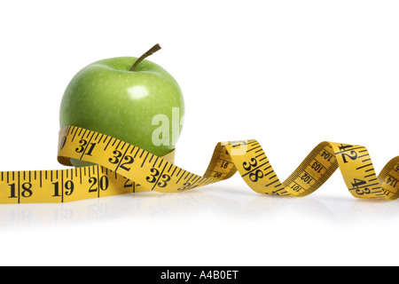 Apple and Tape Measure cut out on white background - Stock Photo