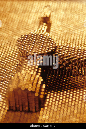 Impression of a hammer head pushed out in a pin matrix toy - Stock Photo