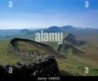 View west along Hadrian's Wall from Sewingshields Crag in summer, Northumberland, England, UK. - Stock Photo