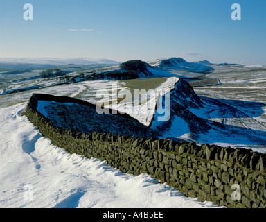 View west along Hadrian's Wall from Sewingshields Crag in winter, Northumberland, England, UK. - Stock Photo