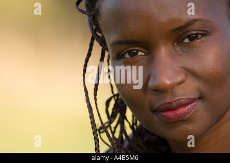 African American girl with braided hair, head and ...
