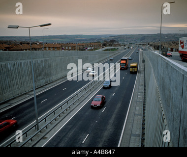 Trunk road intersection showing slip roads, concrete retaining walls, noise barriers, etc. - Stock Photo