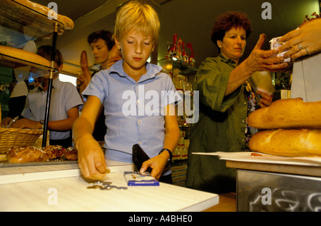 CHILDREN SHOPPING FOR BREAD. The school has an annex at Saveterre Chateau near Toulouse, France - Stock Photo