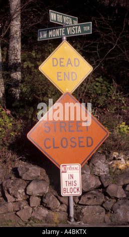 Multi-level street sign, 5 on 1 post, warn warning, direction, information, dead end street closed, no parking, - Stock Photo