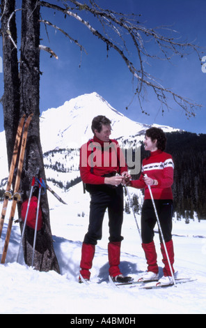 32,587.55100 Man & Woman Cross-country Skiing on Mt Hood vertical landscape copy space copyspace magazine cover - Stock Photo