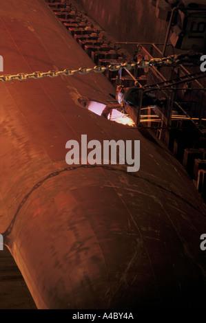 welders work on ship in dry dock falmouth docks - Stock Photo