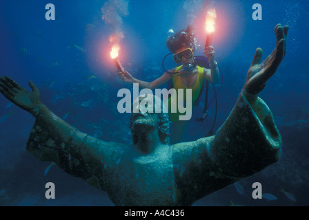 DIVER AND THE STATUE OF CHRIST OF THE ABYSS KEY LARGO FLORIDA - Stock Photo