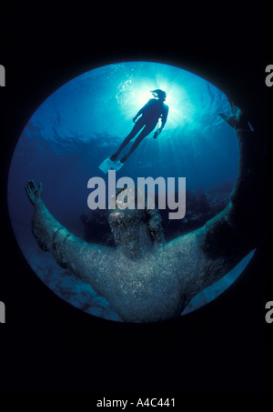 SCUBA DIVER AND STATUE OF CHRIST OF THE ABYSS FLORIDA KEYS NATIONAL MARINE SANCTUARY KEY LARGO FLORIDA - Stock Photo