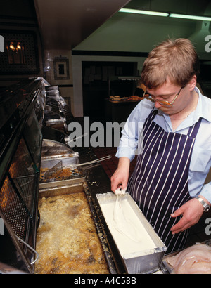 Deep fat frying Harry Ramsdens Fish and Chip Shop Guiseley Yorkshire - Stock Photo