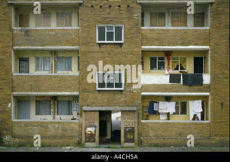 'Two flats in this run down housing estate in Liverpool, England are still occupied but most of the flats are boarded - Stock Photo