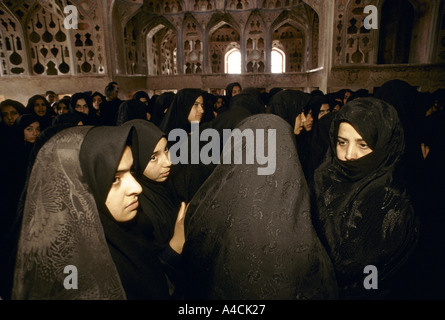 A group of school girls in the music room of the 17th century Ali Qapu palace in the centre of Esfahan - Stock Photo