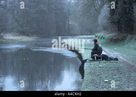 Angler fishing from canal bank. Staffordshire - Worcestershire Canal. Gothersley. England - Stock Photo