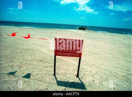 No Lifeguard On Duty sign on Rockaway Beach in New York City - Stock Photo