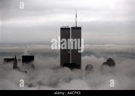 The World Trade Center rises above the fog - Stock Photo