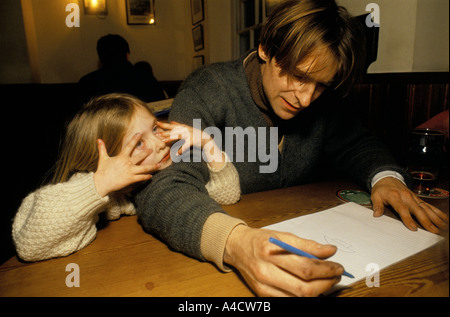 SMOKESTOP' LUNDY ISLAND 1994, SMOKESTOPPER WITH HIS DAUGHTER IN A PUB ON THE ISLAND - Stock Photo