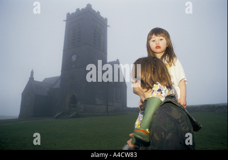 SMOKESTOP' LUNDY ISLAND 1994, SMOKESTOPPER & HIS DAUGHTER WALK PAST ST HELINA'S CHURCH IN THE MIST OF A FOGGY DAY. - Stock Photo