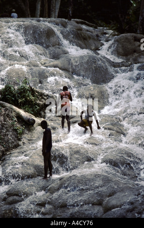 Three young teenagers playing in Dunns River Falls, Jamaica - Stock Photo